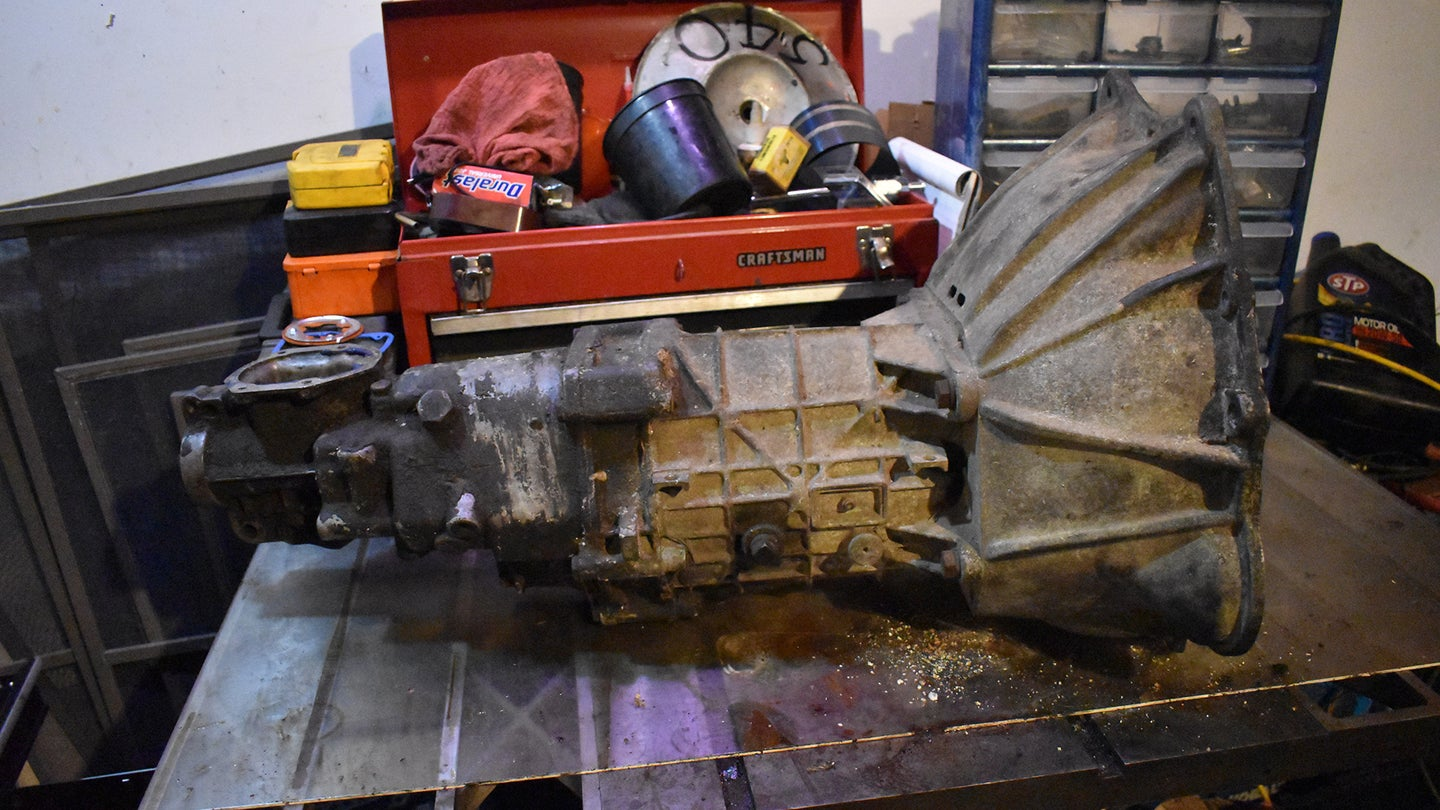 A manual transmission on a work bench.