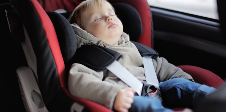 child in an infant car seat