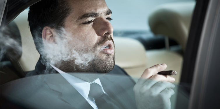 smoking cigarette inside of a car