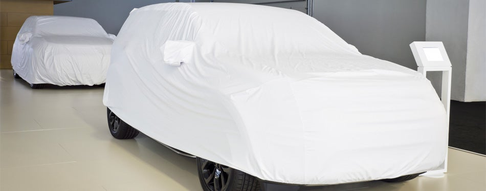 cars covered with white protective covers