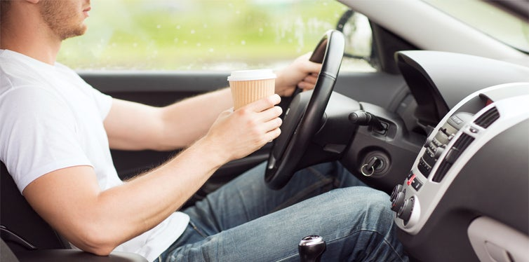 having coffee while driving