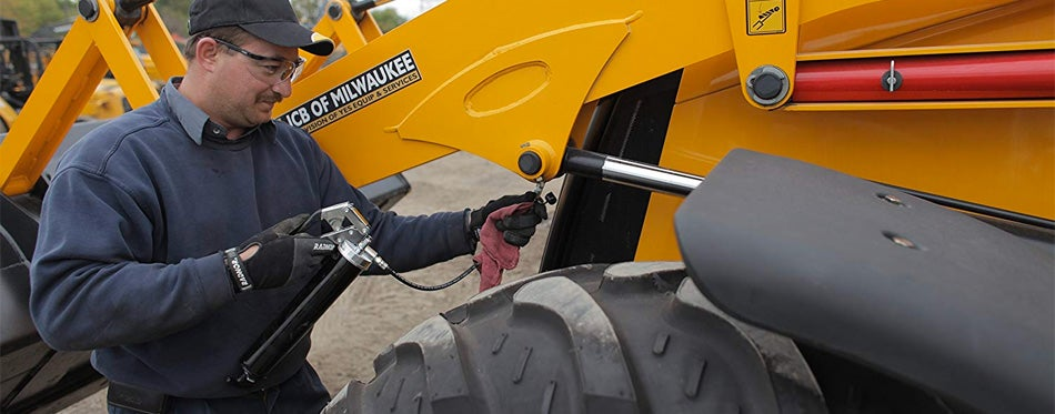 man using a grease gun