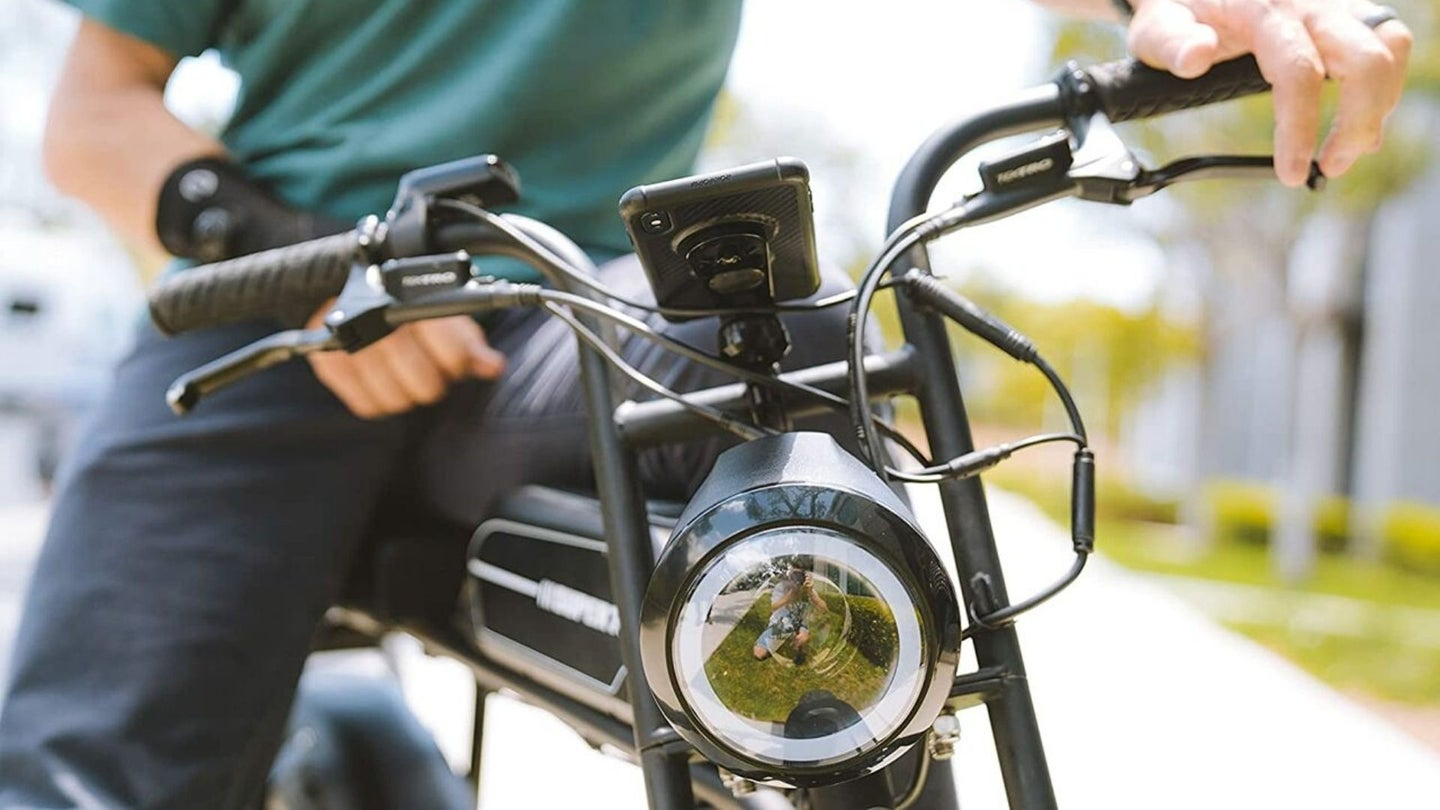 A man riding motorcycle with phone mount installed