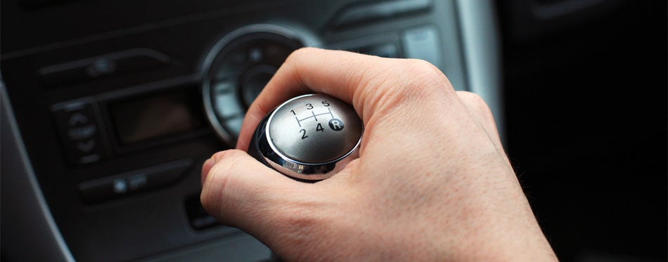 car shift knob in a man's hand