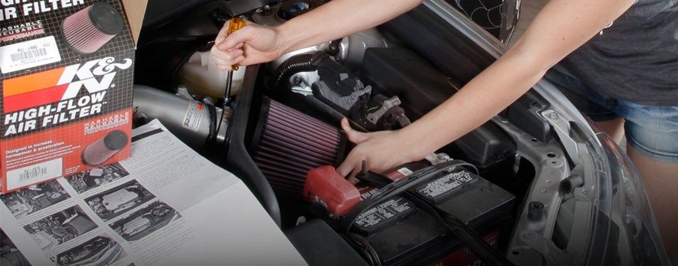 installing cold air intake into vehicle