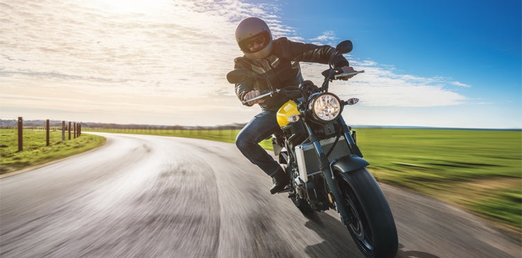 motorcyclist riding under a good weather