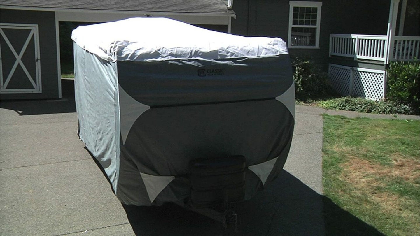 RV covered in the backyard