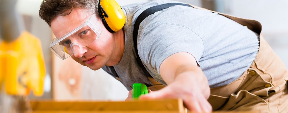 man working and wearing safety glasses