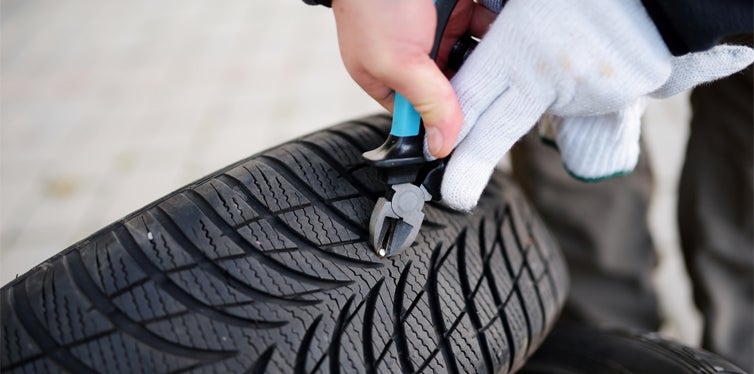pulling out a nail from a tire