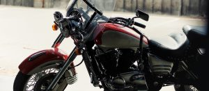 Parked red motorcycle with gps tracker