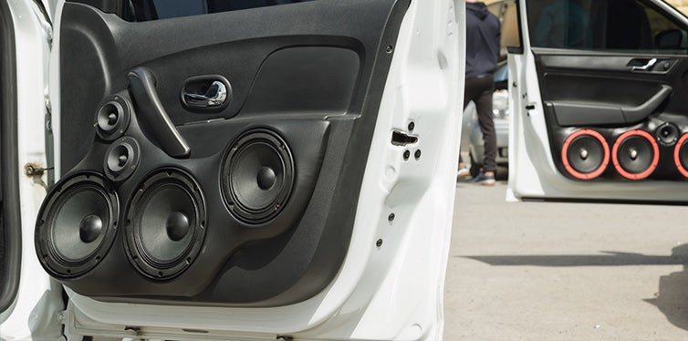 Car with a large number of installed audio speakers