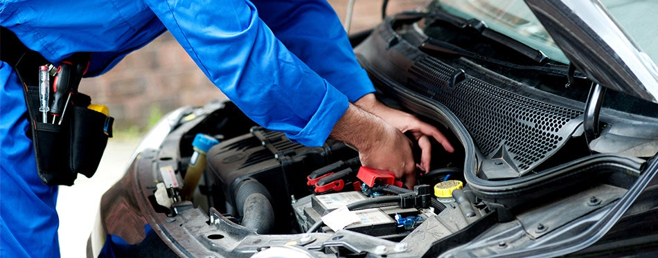 Mechanic repairing car engine