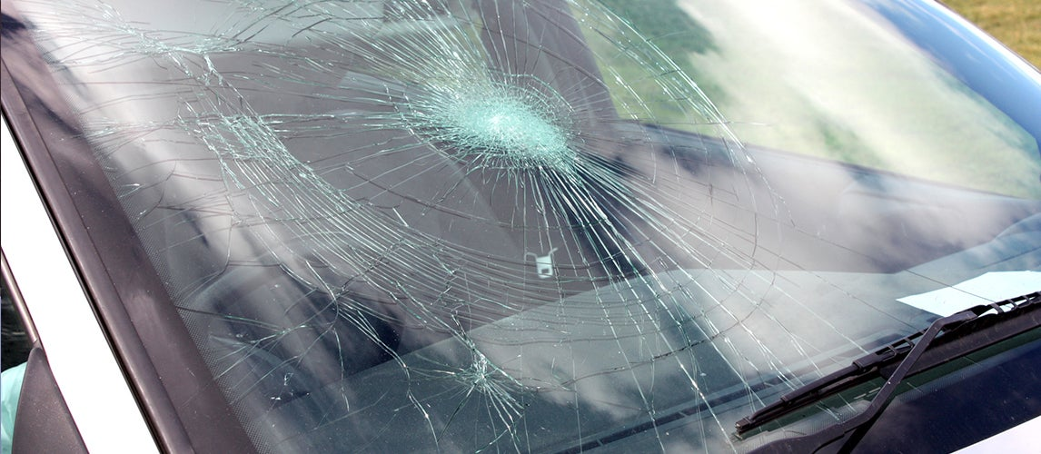 what causes windshields to crack