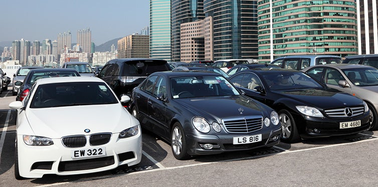 Luxury cars in parking lot