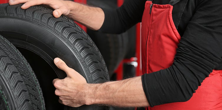 Car mechanic working in tire store