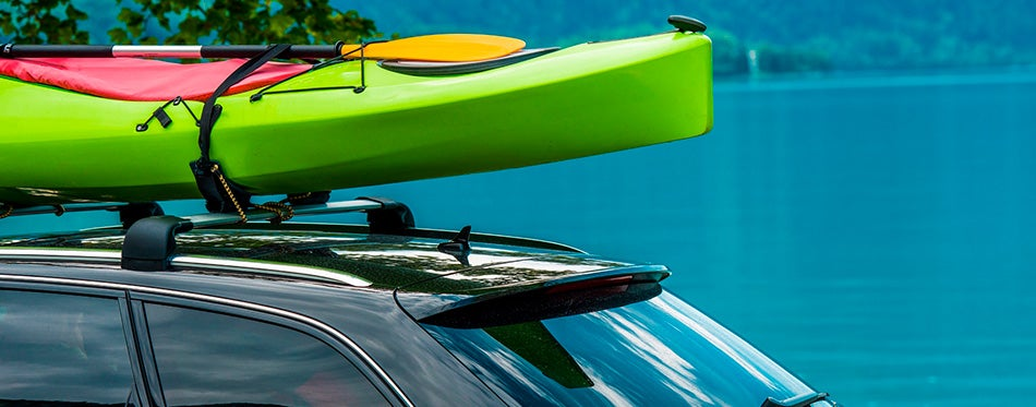 Kayak Roof Rack and the Green Kayak Mounted on the Vehicle