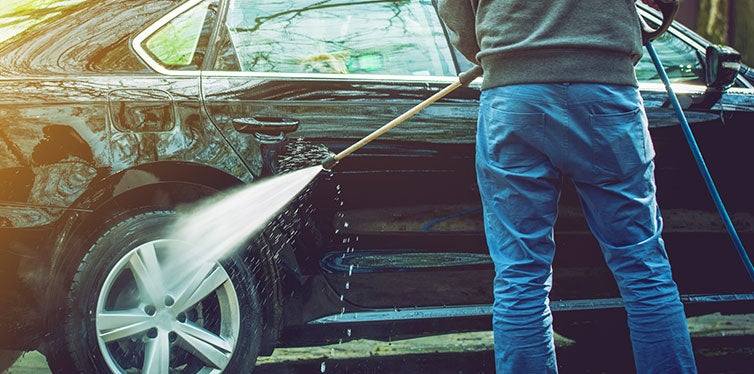 Men Cleaning His Modern Car