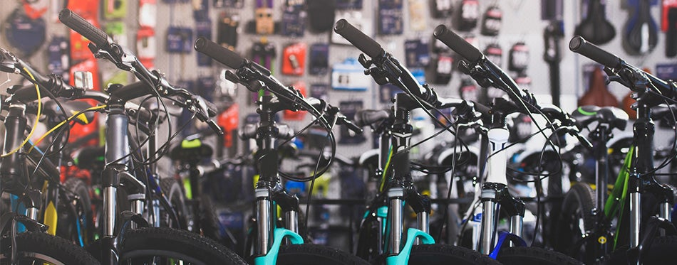 Various modern bikes selling in bicycle shop
