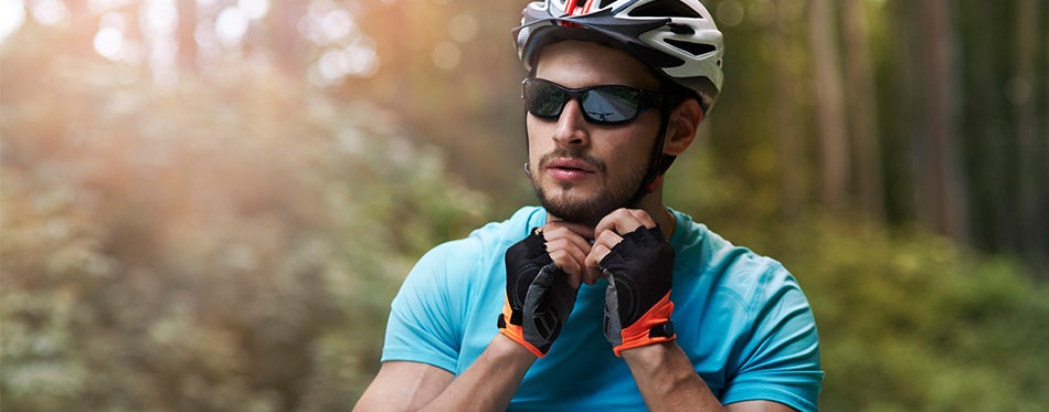 Young man on bicycle in sunglasses