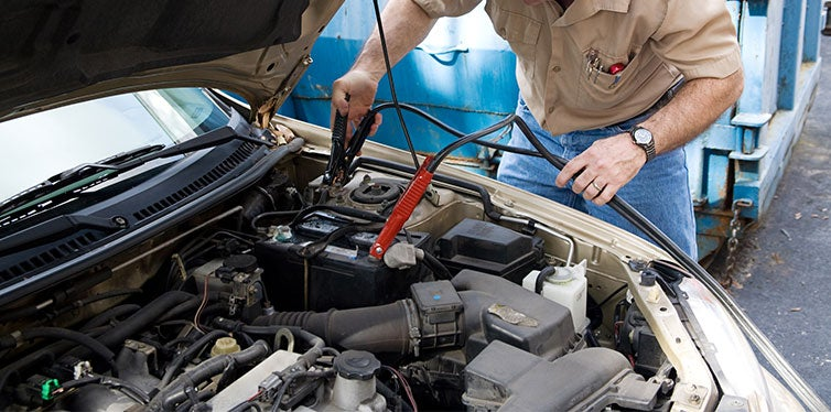 Auto Mechanic use Jumper Cables