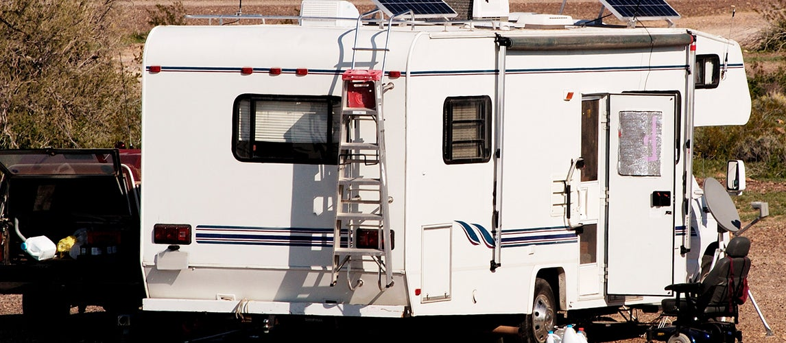 RV Outside in the Nature with Ladders Mounted