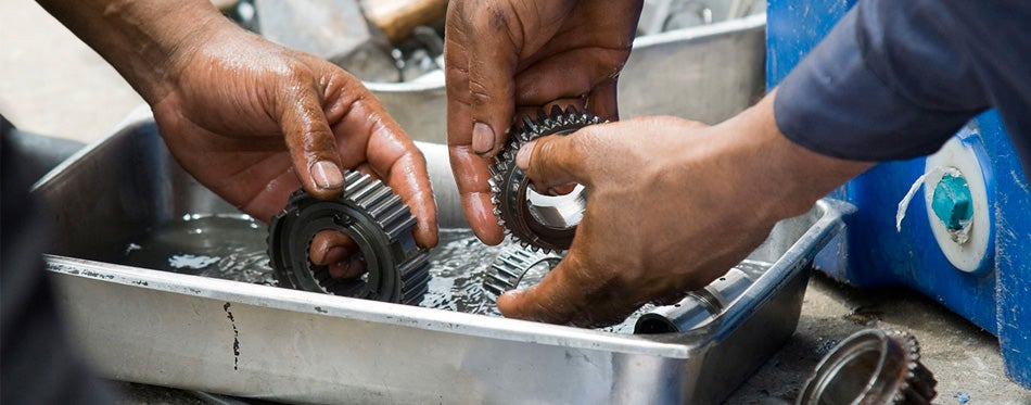 man using parts washers