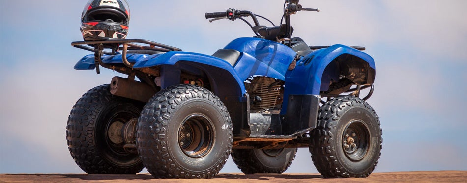 off-road helmet on blue ATV