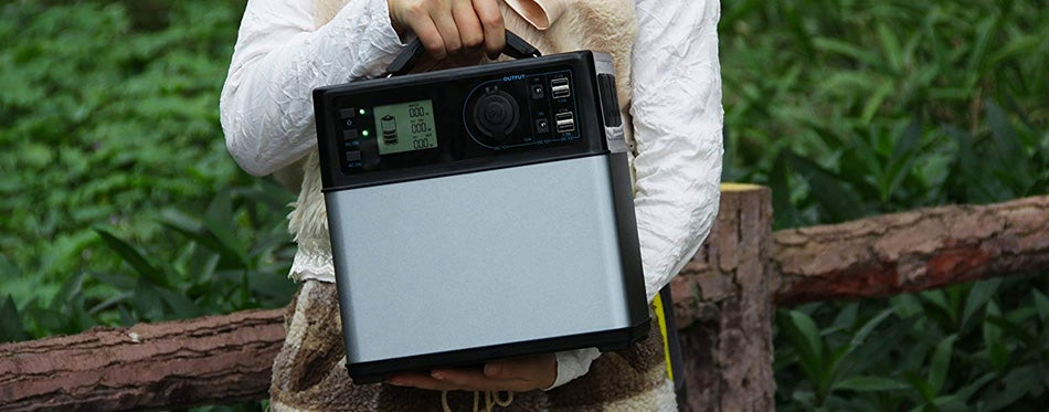 woman holding portable power supply