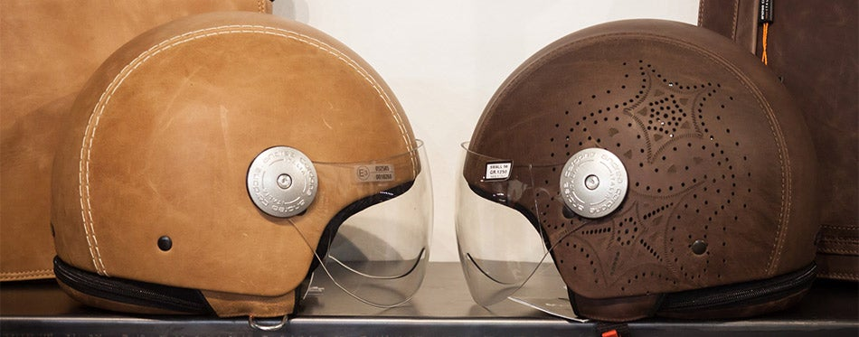 Leather covered helmets on display