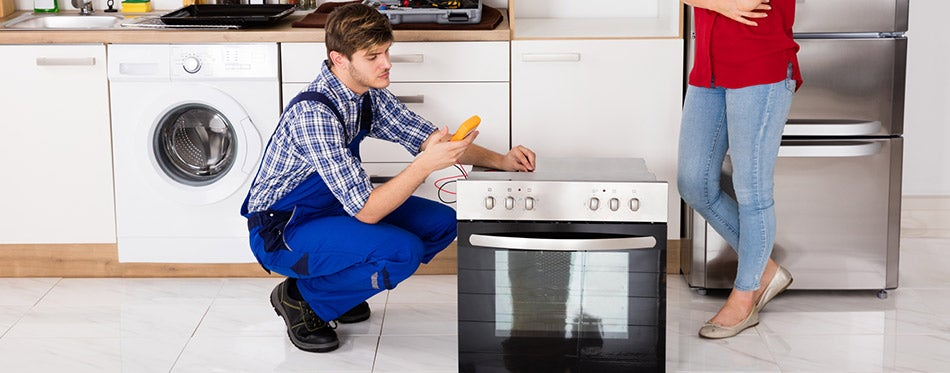 Man repairing the oven