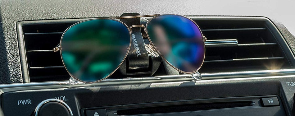Sunglasses on a holder in the car