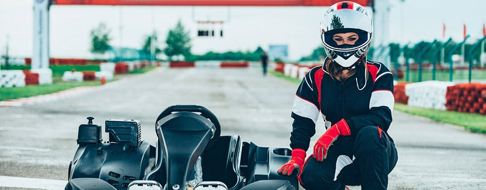 Woman sitting at go-cart on a sports track
