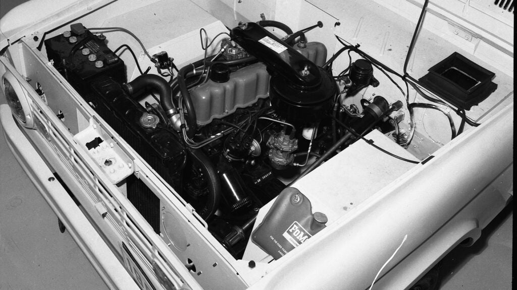 The engine bay of a 1966 Ford Bronco.