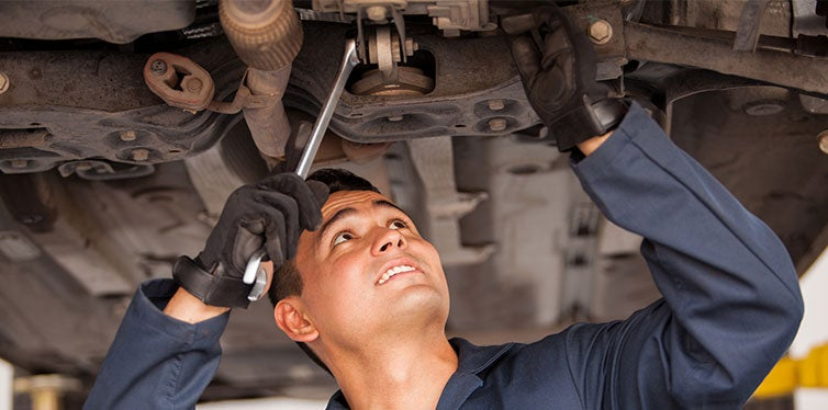 Car mechanic examining car
