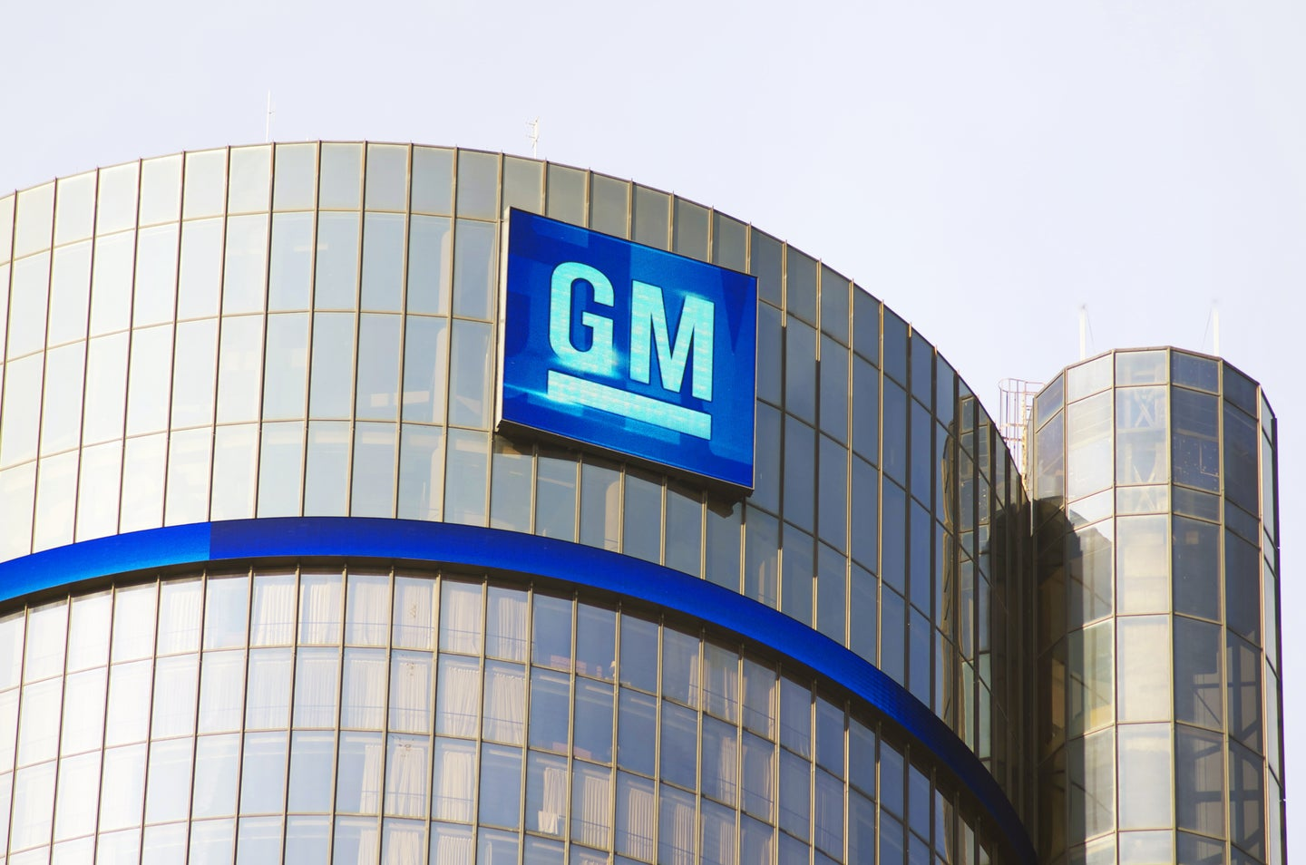 GM logo on the side of a building