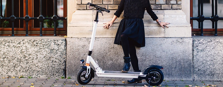 woman on electric scooter