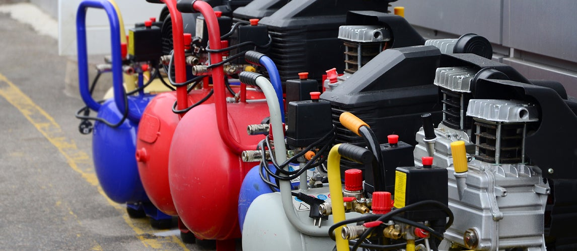 Various 110V air compressors in a row