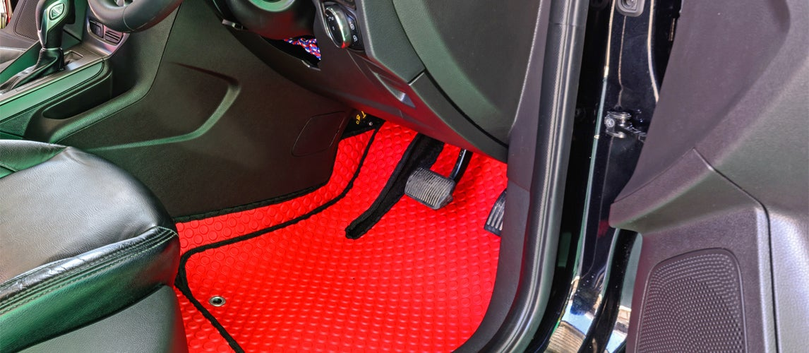 Bright Red all-weather floor mat inside car interior