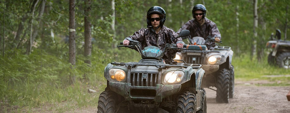 Female ATV riding on the forest road