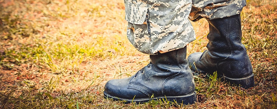 Man stands in military boots