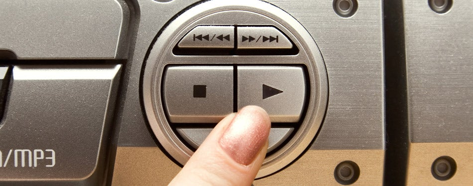 Press play button on audio system