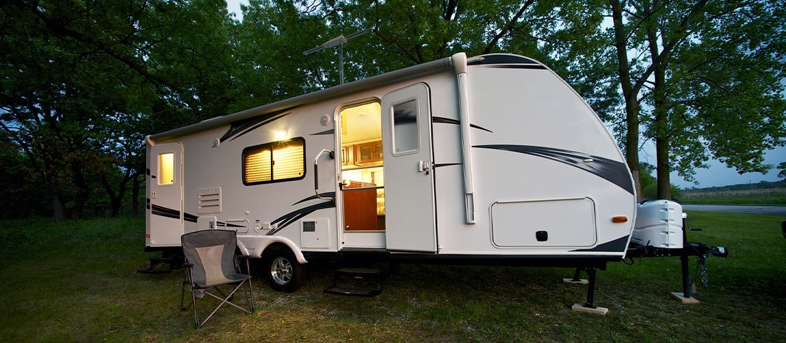 Parked rv with interior lights turned on