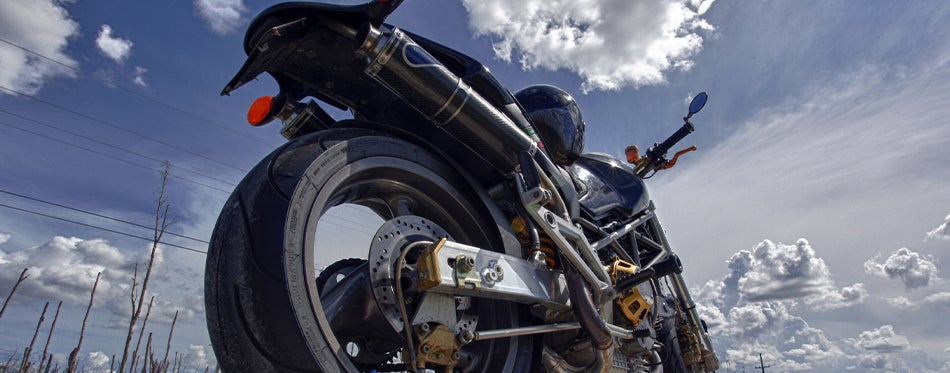Down view of motorcycle with fender eleminators and the sky