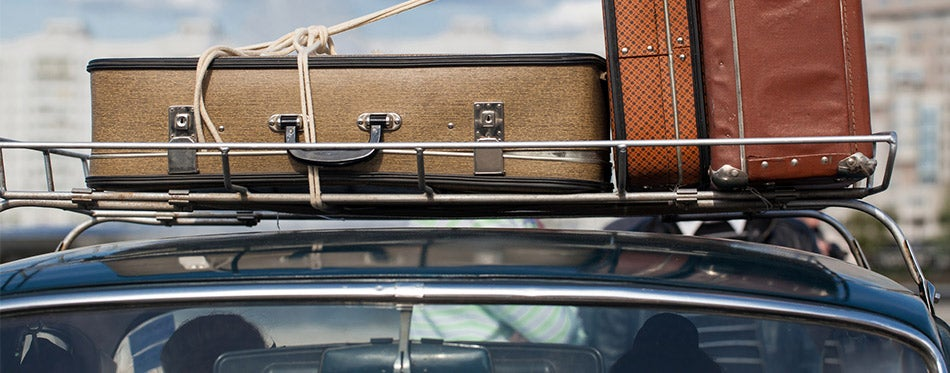 Suitcases on a car roof