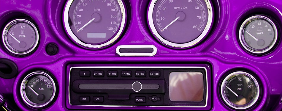 Gauges and motorcycle radio on motorcycle dashboard
