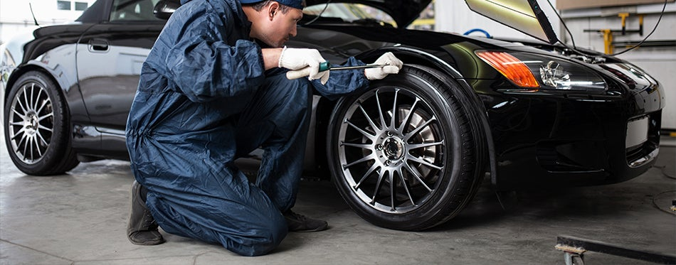Helo wheels on a sports car being checked