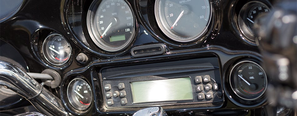 Motorcycle dashboard with fairing speaker system