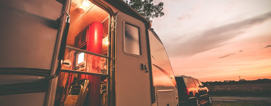 RV facing the sunset with led replacement lights turned on