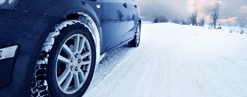 Black car with americal racing wheels on snow