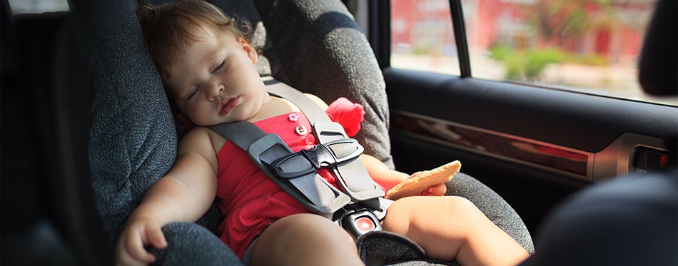 Child sleeping on a car without car sun shade